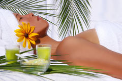 Pretty asian woman relaxing. At a spa with white background Royalty Free Stock Image