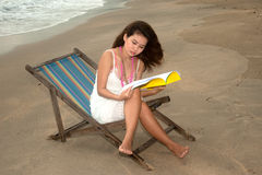 Pretty Asian woman relaxing on the beach. Royalty Free Stock Images
