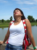 Pretty Asian woman rests under the sun Stock Images
