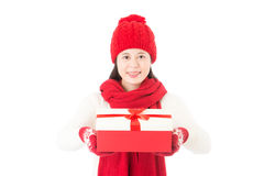 Pretty asian woman showing and giving red gift with ribbon Royalty Free Stock Photos