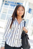Pretty asian woman standing and looking the camera Stock Image
