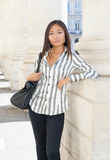 Pretty asian woman standing and looking the camera Royalty Free Stock Image