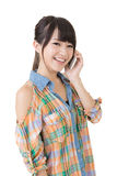 Pretty asian woman talking on cell phon Stock Photography