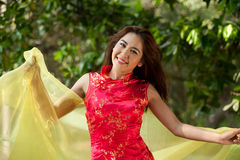 Pretty Asian  woman in traditional dress in a cheerful manner. Royalty Free Stock Photos