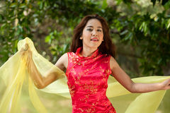 Pretty Asian  woman in traditional dress in a cheerful manner Stock Photography