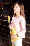 Pretty Asian woman with ukelele stock photo
