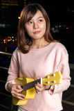 Pretty Asian woman with ukelele stock image