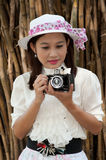 Pretty Asian woman use vintage camera . Stock Photo