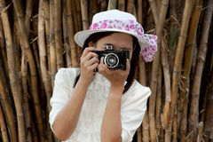 Pretty Asian woman use vintage camera . Royalty Free Stock Image