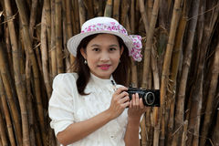 Pretty Asian woman use vintage camera. Royalty Free Stock Image