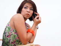Pretty Asian woman uses mobile phone Stock Photos