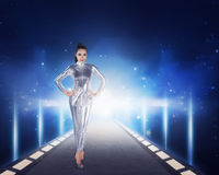 Pretty asian woman wearing latex jumpsuit. Inside cyber world concept Royalty Free Stock Images