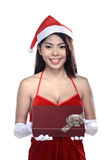 Pretty asian woman wearing santa claus costume holding gift box Royalty Free Stock Image