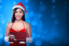 Pretty asian woman wearing santa claus costume holding gift box Royalty Free Stock Photography