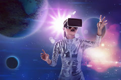 Pretty asian woman wearing silver latex jumpsuit and VR headset Stock Photography