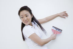 Pretty Asian woman working on house Stock Photo