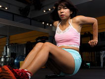 Pretty Asian woman works out Stock Image