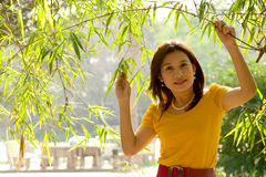 Pretty Asian woman in yellow dress . Royalty Free Stock Photography