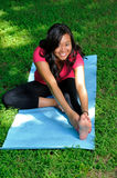 Pretty Asian woman - yoga in the park Stock Photography