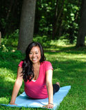 Pretty Asian woman - yoga in the park Royalty Free Stock Photography