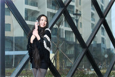Pretty asian women on cell phone Stock Photo