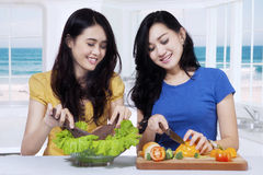 Pretty Asian women cooking salad Royalty Free Stock Image