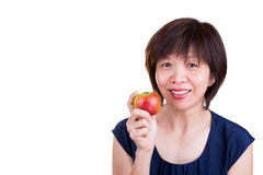 Pretty Asian women holding apple promotes healthy diet. Pretty Asian woman holding apple promotes fiber rich healthy diet Royalty Free Stock Photo