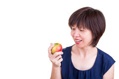 Pretty Asian women holding apple promotes healthy diet Royalty Free Stock Photo