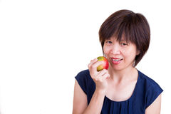 Pretty Asian women holding apple promotes healthy diet. Pretty Asian woman holding apple promotes fiber rich healthy diet Stock Photography