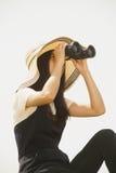Pretty Asian young woman seeking Binoculars . Stock Photos