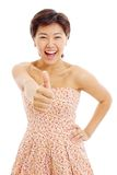 Pretty asian young woman shows thumb up Stock Photography