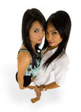 Pretty asians. Beautiful, young asian women photographed with a wide angle lens, isolated on white stock image
