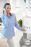 Pretty assistant talking on cellphone Stock Photography
