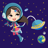 Pretty Astronaut Girl. Pretty astronaut fashion girl exploring space from her flying ship orbiting the earth Royalty Free Stock Images