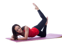 Pretty athlete exercising on gymnastic mat Royalty Free Stock Images