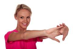 Pretty Athlete Stretching Stock Photos