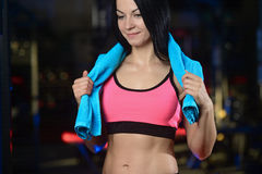 Pretty athletic fitness woman with towel in the gym Royalty Free Stock Photo