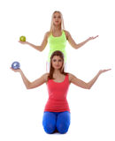 Pretty athletic girls posing with gymnastic balls Royalty Free Stock Photos