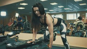 Pretty Athletic Woman Doing Dumbbell Bench Exercise in sport club.  stock video footage