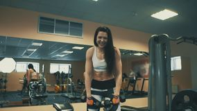 Pretty Athletic Woman Smiling during doing exercise in sport club.  stock video footage