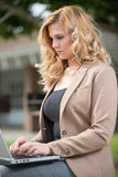 Pretty attractive blond caucasian business woman Stock Photos