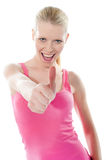 Pretty attractive girl showing thumbs-up Stock Image
