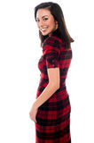 Pretty attractive girl smiling. Smiling young girl in trendy attire and looking back Royalty Free Stock Photo