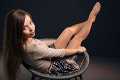 Pretty attractive sexy woman lies on a chair Stock Photos