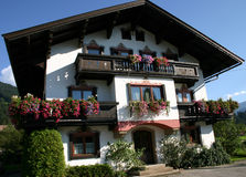 Pretty Austrian house. Pretty flower decked Austrian house in the Tyrolean village of Kirchberg Stock Photo