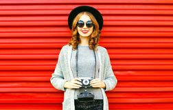 Free Pretty Autumn Happy Girl Holds Retro Camera On Red Background Stock Photos - 123064103