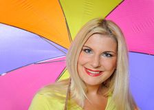Pretty autumn woman standing under umbrella Stock Photo