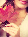 Pretty autumnal girl with maple leaves in hand Stock Photo