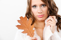 Pretty autumnal girl with oak leaf in hand Stock Image