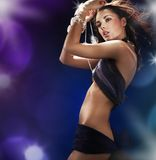 Pretty babe dancing in a nightclub Stock Photos